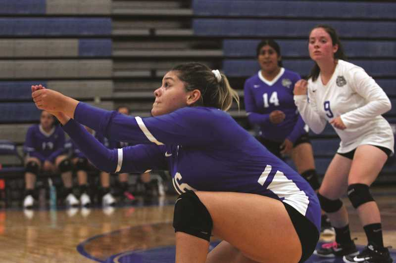 PMG PHOTO: PHIL HAWKINS - Despite the 0-3 start to the season, Woodburn junior Yamileth Rios is confident this years team can pick up an elusive victory for the Bulldog volleyball program this year.