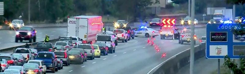 COURTESY PHOTO: KOIN 6 NEWS - Traffic on Interstate 84 was squeezed to one lane Wednesday morning, Sept. 11, after a pedestrian was killed on the highway nearly 207th Avenue.