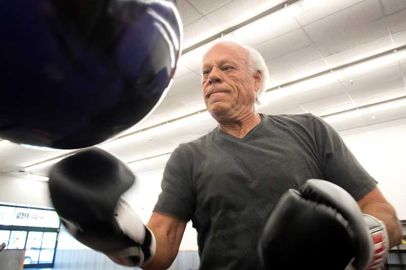 PMG PHOTO: JAIME VALDEZ - Bill Gumpenberger punches the bag at Kimberly Bergs Rebel Fit Club in downtown Tigard.
