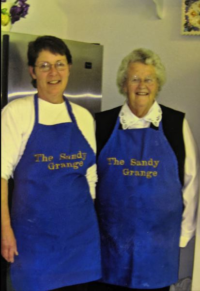 COURTESY PHOTO - Sandy Grange members like Karen Cansler and her mother often meet around a meal cooked in the hall kitchen.
