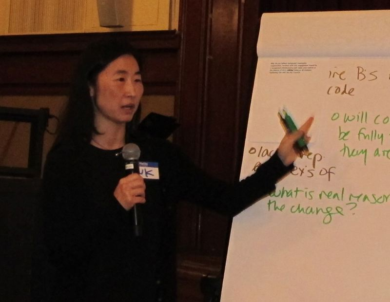PMG PHOTO: BILL GALLAGHER - Suk Rhee, director of the Office of Communiyt and Civic Life,  wrote down questions from the audience before her presentation Tuesday, September 10 at the Multnomah Arts Center.