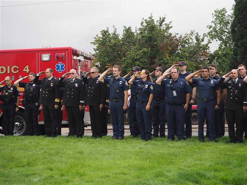 PMG PHOTO: MAX EGENER - Firefighters from Washington County stand at attention during the tolling of the bells at a ceremony in Forest Grove on Wednesday to honor of the victims of the Sept. 11, 2001 terrorist attacks.