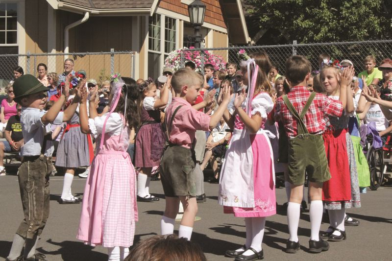 PMG FILE PHOTO - First-graders dance for visitors in 2018's Mount Angel Oktoberfest.
