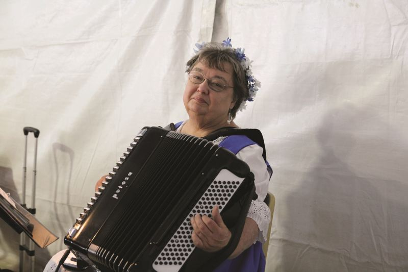PMG FILE PHOTO - Longtime volunteer Marlene Meissner has been playing the accordian at Mount Angel's Oktoberfest every year since 1966.