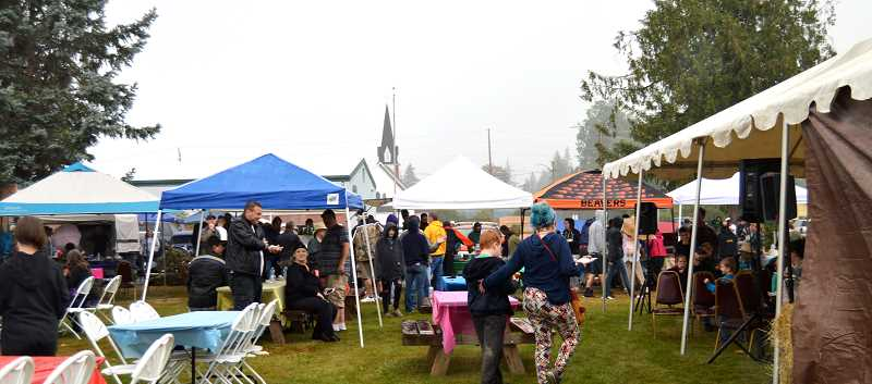 PMG PHOTO: CINDY FAMA - A rainy Colton evening does not stop the luau fun.