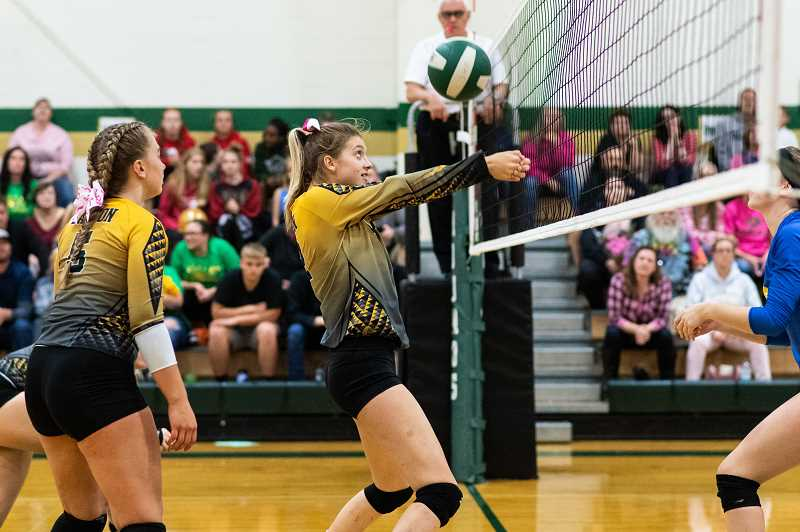 PMG PHOTO: CHRISTOPHER OERTELL - Gaston sophomore Mackenzie Berger during a Greyhounds game last season at Gaston High School. Berger will be a key component to this year's team.