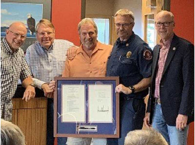 SUBMITTED PHOTO - Rep. Greg Walden, far right, stops at the Crooked River Ranch Fire Station to present officials with a signed copy of the recently passed Crooked River Ranch Fire Protection Act.