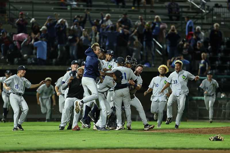 COURTESY PHOTO: CRAIG MITCHELLDYER - Hillsboro Hops players celebrate their NWL championship after recording the final out in their 3-1 win over Tri-City in Game 5 of the NWLCS Wednesday night, Sept. 11, in Pasco, WA.
