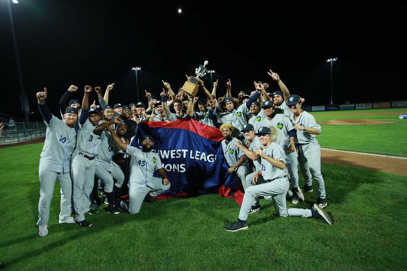 COURTESY PHOTO: CRAIG MITCHELLDYER - Hops players pose for a photo with the NWL Championship trophy shortly following their 3-1 win in Game 5 of the NWLCS Wednesday, Sept. 11, in Pasco, WA.