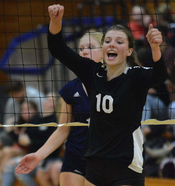 PMG PHOTO: DAVID BALL - Corbetts Morgan Stafford celebrates a point during the Cardinals three-set sweep over Marist on Tuesday night.