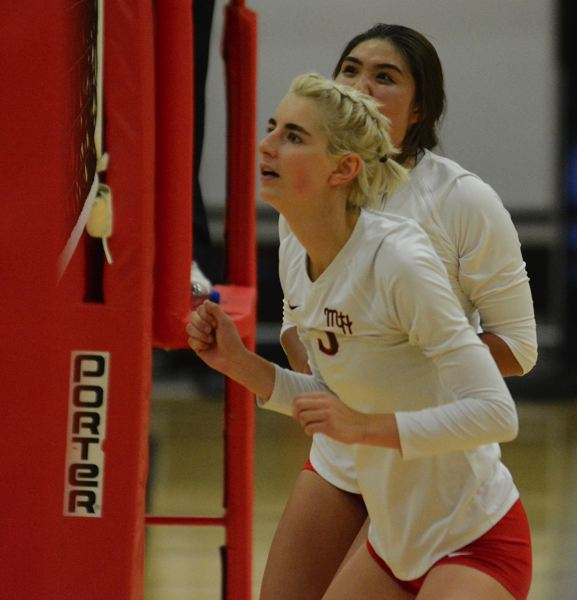 PMG PHOTO: DAVID BALL - Mt. Hoods Zoe Chatterton out of Corbett High watches the ball through the net after putting up a block during the Saints five-set win over Clark College on Wednesday night.