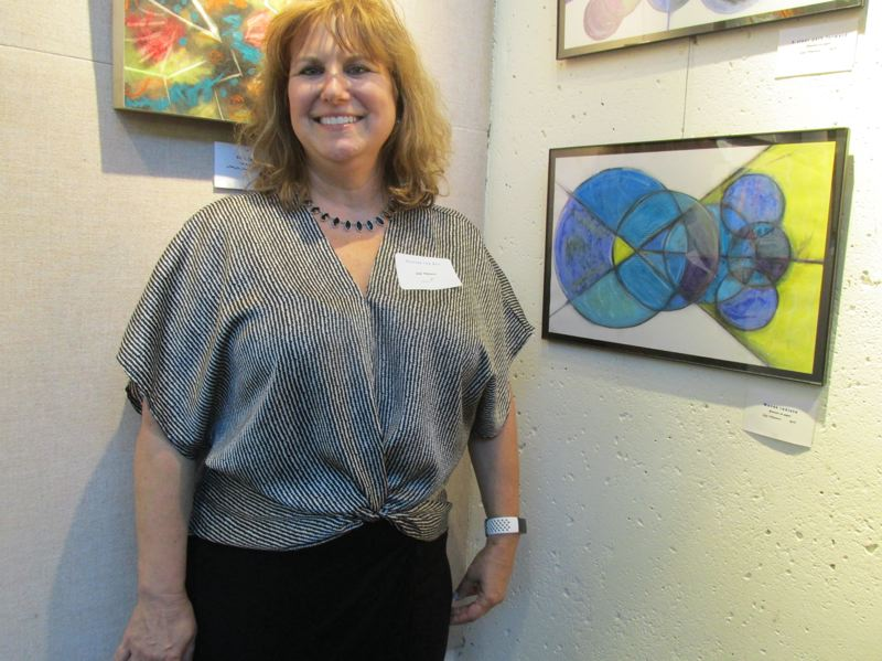 PMG PHOTO: SHANNON O. WELLS - Gigi Matacco stands by her Waves Radiate pastel painting, one of two she submitted for the Outside the Box show.