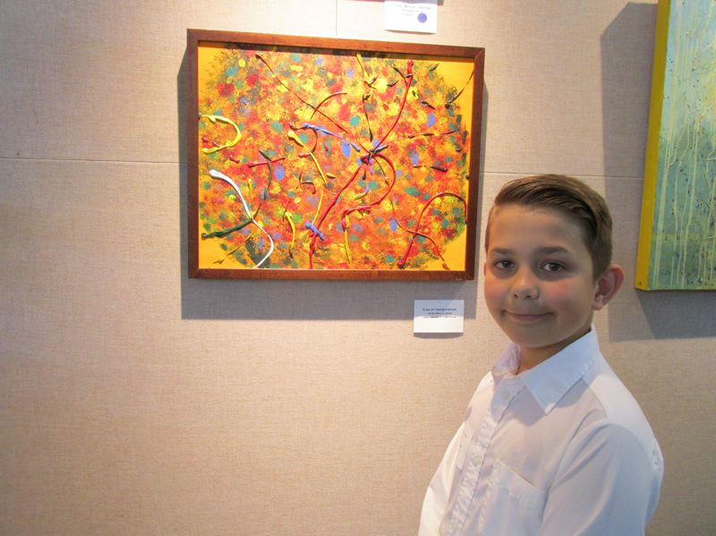PMG PHOTO: SHANNON O. WELLS - Simeon Bassett, 10, started work on his abstract, multicolored Tree of Imagination earlier this summer.
