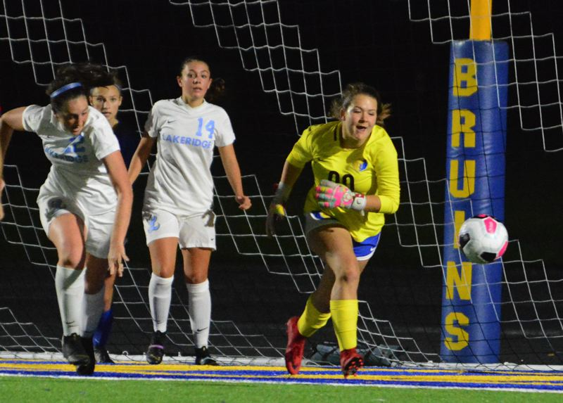 PMG PHOTO: DAVID BALL - Barlow goalie Elizabeth Springer runs onto a loose ball in front of the net ahead of a pair of Lakeridge strikers.