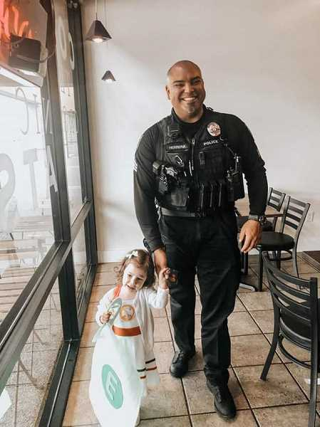 COURTESY PHOTO: GRESHAM POLICE DEPARTMENT - Sergeant John Herrera walks with a young community member.