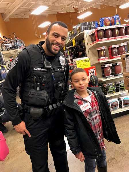 COURTESY PHOTO: GRESHAM POLICE DEPARTMENT - Officer Matthew Harris-Myers during the annual Shop with a Cop event.