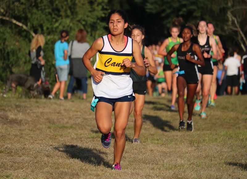 PMG PHOTO: JIM BESEDA - Canby senior Jennifer Torres finished third at the Three Rivers League Preview Wednesday at Clackamas Community College.