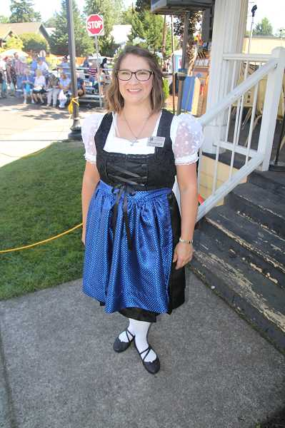 PMG PHOTO: JUSTIN MUCH - Mount Angel Mayor Kelly Grassman said a favorite part of Oktoberfest for many, including her, is getting dressed up and sampling the food.