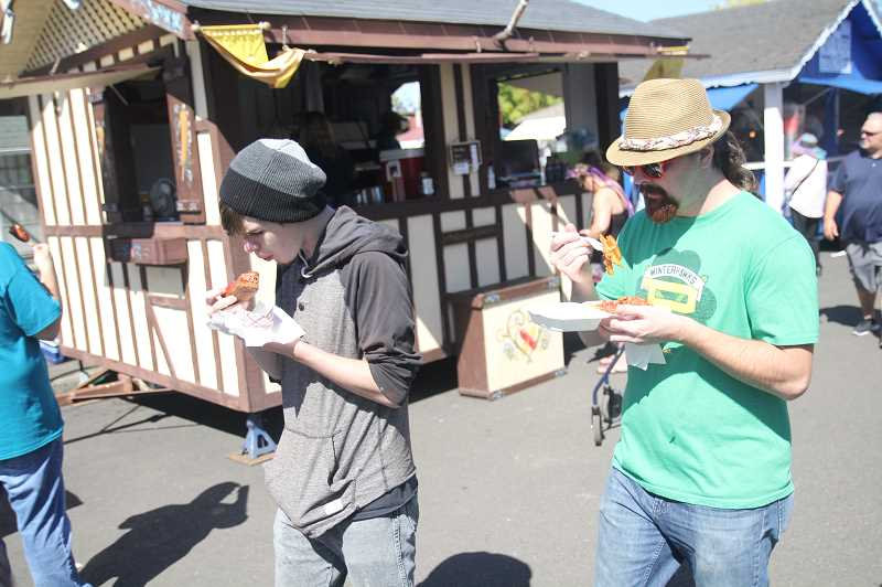 PMG PHOTO: JUSTIN MUCH - The food is always a popular draw at the Oktoberfest in Mount Angel.