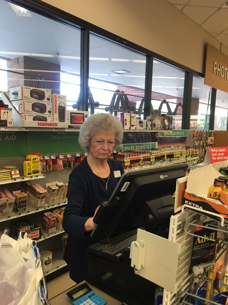 PMG PHOTO BY PETER WONG - Dolly Bailey, 92, is a 30-year cashier at Rite Aid at Tigard Towne Square, which serves King City.