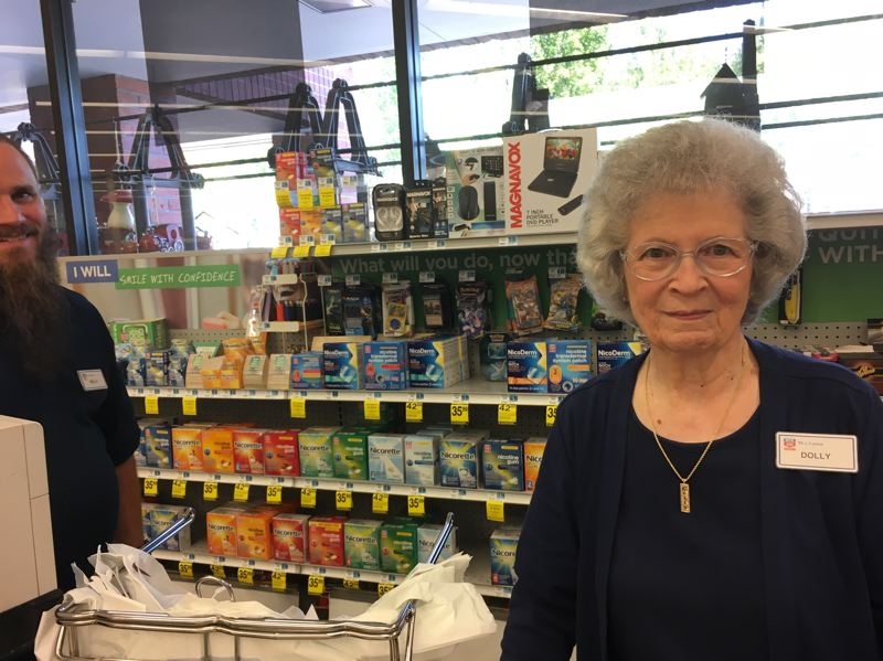 PMG PHOTO BY PETER WONG - Dolly Bailey, 92, has worked as a cashier for 30 years at Rite Aid pharmacy and store at Tigard Towne Square serving King City.
