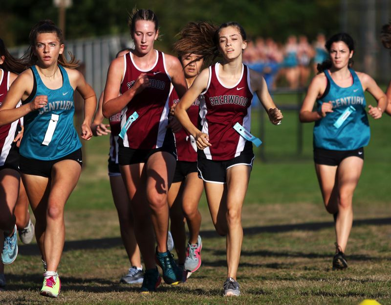 PMG PHOTO: DAN BROOD - Sherwood junior Kari Eddington (second from right), with teammate Brooke Smith to her right, ran to victory in the varsity girls race in the meet at Century.