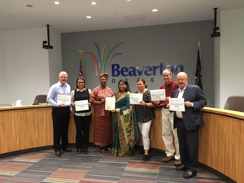 PMG PHOTO BY PETER WONG - Beaverton City Council approves proclamation for Welcoming Week, which is Sept. 13-22, at a council meeting Sept. 10. From left are Councilor Mark Fagin, Councilor Laura Mitchell, Wambui Machua, Sushmita Poddar, Councilor Lacey Beaty, Councilor Marc San Soucie and Mayor Denny Doyle. Councilor Cate Arnold participated by phone.