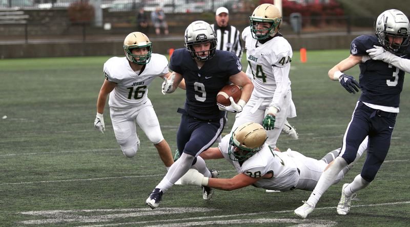 PMG PHOTO: MILES VANCE - Lake Oswego senior running back Casey Filkins and the Lakers face Jesuit for the third time in a year when they host the Crusaders at 7 p.m. tonight (Friday, Sept. 13) at Lake Oswego High School.
