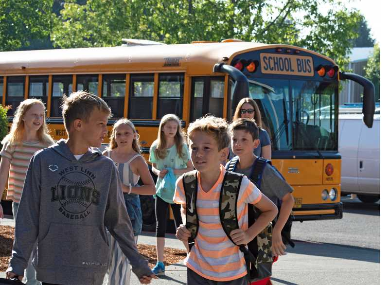 PMG FILE PHOTO  - A bus carrying Boones Ferry Primary students was in a vehicle accident on its way to drop students off at school Thursday morning. The bus and students pictured here were not involved.