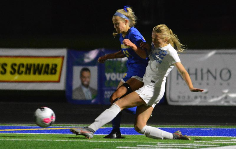 PMG PHOTO: DAVID BALL - Lakeridge's Tessa French makes a sliding kick during her team's 1-1 tie against Barlow at Barlow High School on Wednesday, Sept. 11.