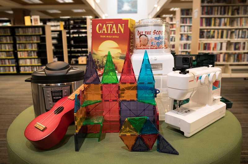 PMG PHOTO: JAIME VALDEZ - Board games like Catan, ice cream makers, Instapots, ukuleles, Manga Tiles and a sewing machine are items patrons can check out at Clackamas County Libraries of Things.