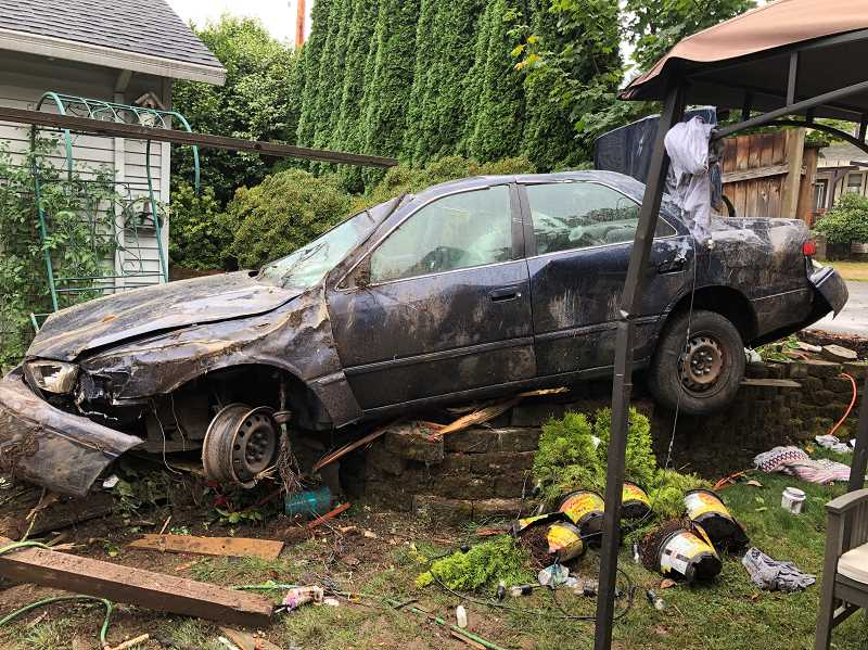 COURTESY TIGARD POLICE DEPARTMENT - A woman driving under the influence of intoxicants crashed into two homes on Merilyn Court early Friday morning.