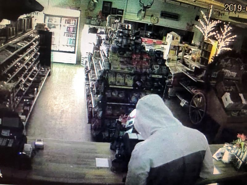 COURTESY PHOTO: MCSO  - Surveillance footage captured an image of a suspect behind the cash register at Corbett Country Market on Historic Columbia River Highway in the early morning hours of Monday, Sept. 9.