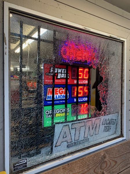 COURTESY PHOTO: MCSO  - A front window was smashed at the Glen Irvin Market in Springdale in the early morning hours of Monday, Sept. 9, not long after a breaking and entering up the road at Corbett County Market.