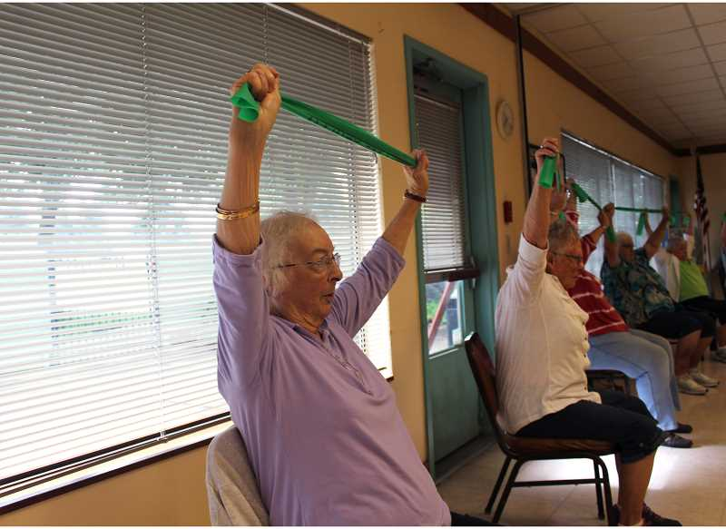 PMG PHOTO: KRISTEN WOHLERS - Janine Miller (left) never likes to miss the Geri-Fit class at the adult center on Mondays and Thursdays.