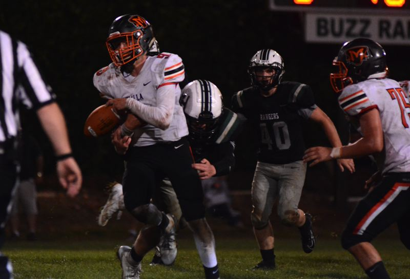 PMG PHOTO: DEREK WILEY - An Estacada defender strips the ball way from Molalla quarterback Isaac Thomas-Klementis.