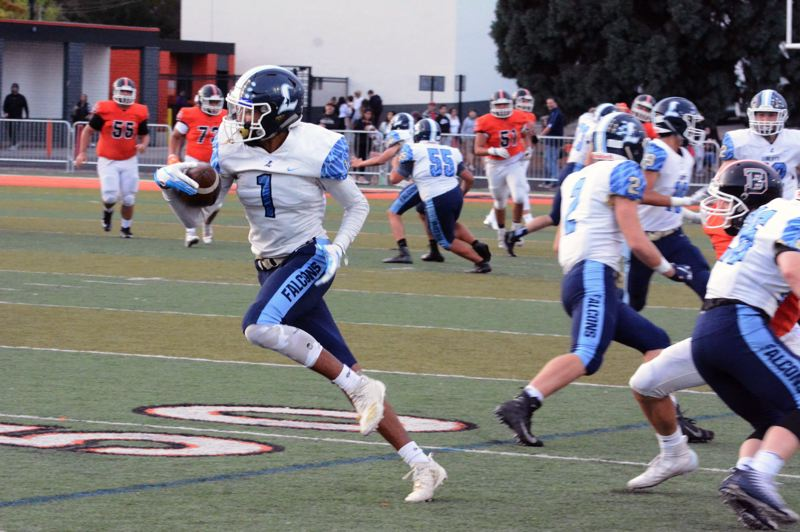 TIMES PHOTO: MATT SINGLEDECKER - Liberty senior Marquis Brown had a big interception in the first quarter against Beaverton.