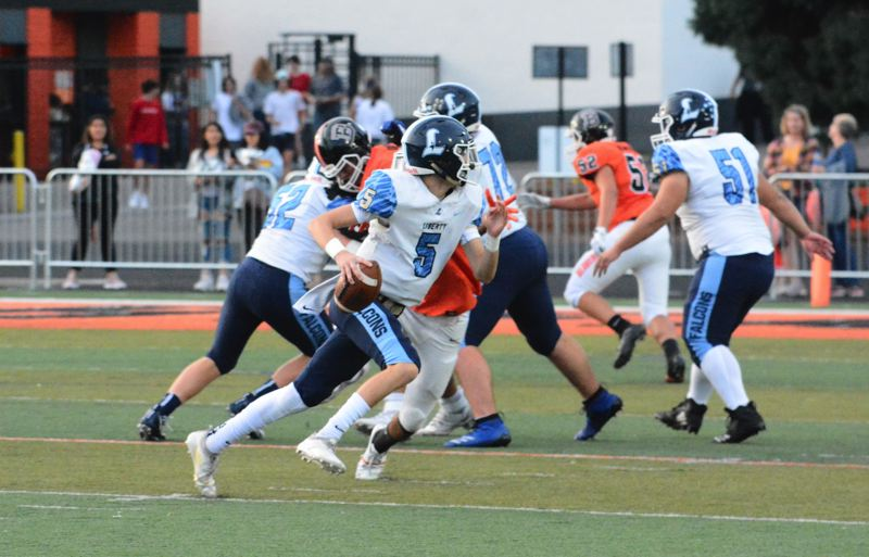 TIMES PHOTO: MATT SINGLEDECKER - Liberty sophomore quarterback Hiro Diamond looks for an open man against Beaverton.
