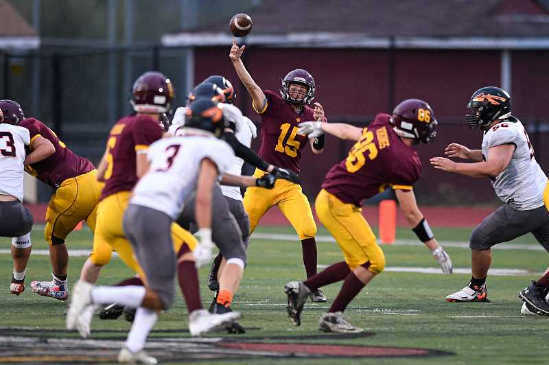 PMG PHOTO: CHRISTOPHER OERTELL - Forest Grove's Jarod Miller throws a pass during the Vikings' game against Scappoose Friday night, Sept. 13, at Forest Grove High School.