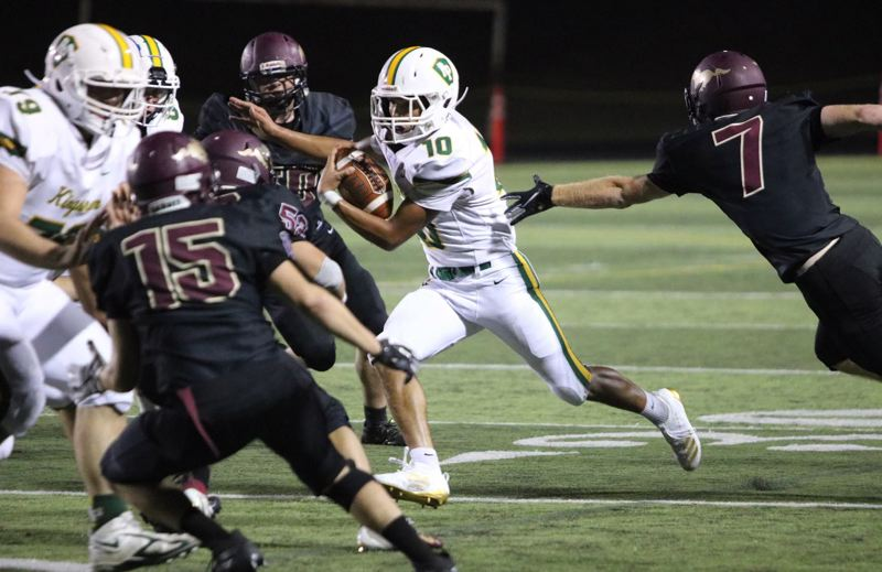 PMG PHOTO: JIM BESEDA - Putnam's Sebastian Callaway had eight carries for a team-high 86 yards rushing and one touchdown to help lead the Kingsmen to a 43-14 road win Friday over Milwaukie.