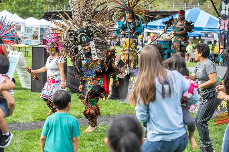PMG PHOTO: JONATHAN HOUSE - Dancers with Danza Azteca perform a Community Dance during Viva Tualatin! held Saturday at Tualatin Community Park.