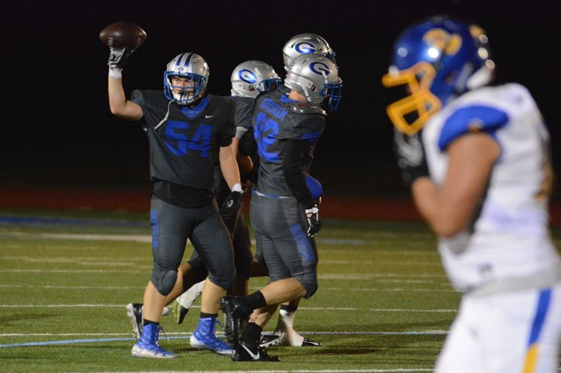 PMG PHOTO: DAVID BALL - Gresham linebacker Gage Cota tosses the ball back to the referee after recovering a fumble in the fourth quarter of Fridays 56-6 loss to Aloha.