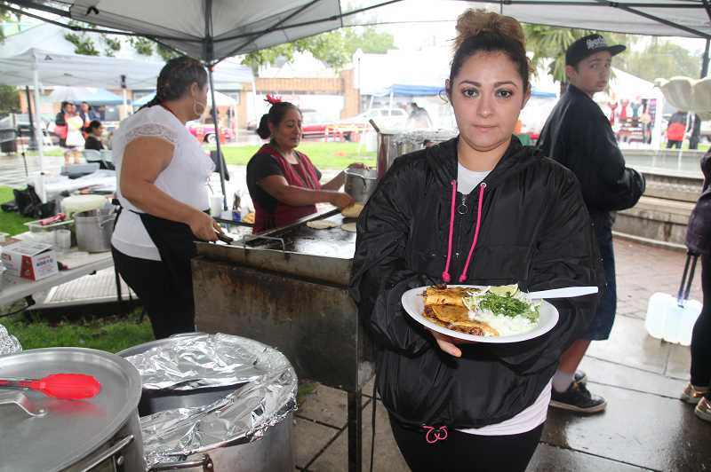 PMG PHOTO: JUSTIN MUCH - Authentic food was part of the fare Sunday at The Plaza in downtown Woodburn as folks celebrated day 1 of Hispanic Heritage Month.