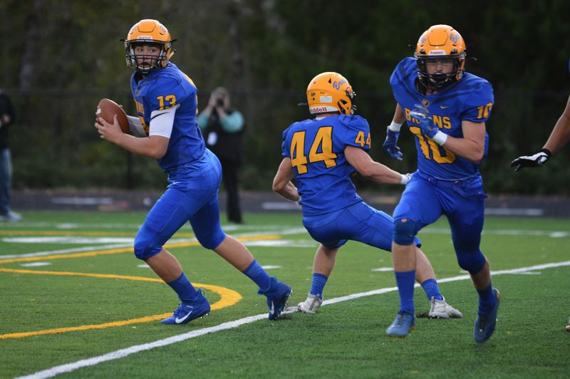 PMG PHOTO: DAVID BALL - Barlow QB Jaren Hunter (13) rolls out with receiver Carter Baggs (10) cutting across the formation.