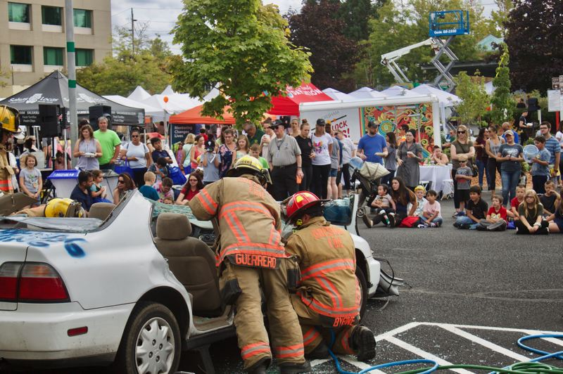PMG PHOTO: CHRISTOPHER KEIZUR - Gresham Fire & Emergency Services did a vehicle rescue demonstration during the event.