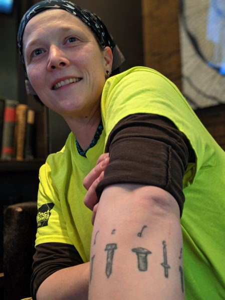 PAMPLIN MEDIA GROUP: JOSEPH GALLIVAN - After studying botany and working in dead-end agribusiness, Rachael Kofahl found her calling as a sheet metal journeyman. She is currently working on the new Multnomah County Courthouse. Kofahl has the different types of sheet metal fasteners tattooed around her left arm.