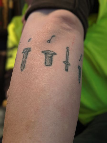 PAMPLIN MEDIA GROUP: JOSEPH GALLIVAN - Rachael Kofahl found her calling as a sheet metal journeyman. Kofahl has the different types of sheet metal fasteners tattooed around her left arm.