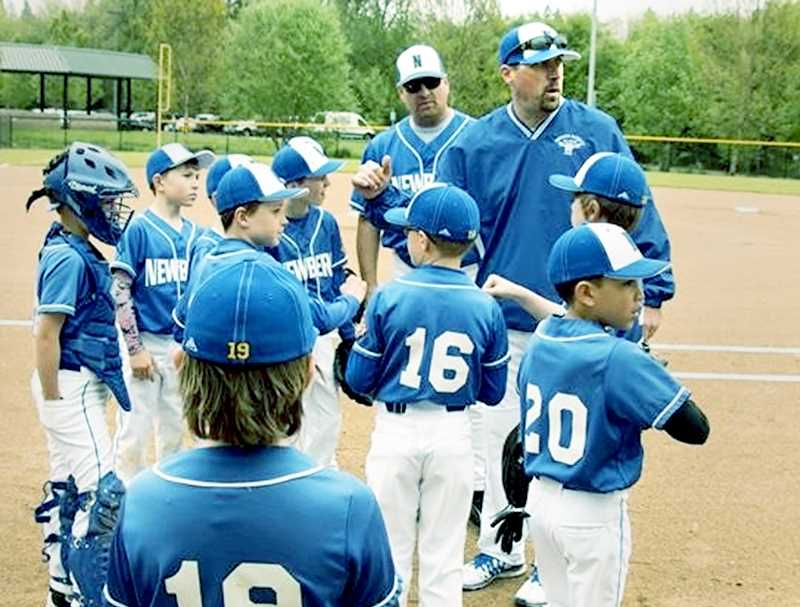 SUBMITTED PHOTO - Ian Holmes coached baseball and football and was intimately involved with youth sports in Newberg before his untimely death in March.