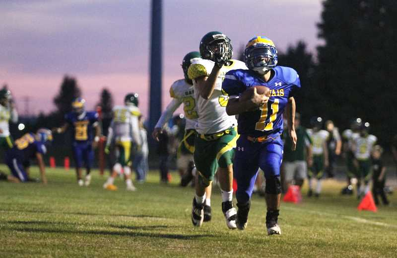 PMG PHOTO: PHIL HAWKINS - Gervais senior Xadan Ramon distances himself from a pair of Gaston defenders on a 66-yard touchdown run in the second quarter of the Cougars 46-20 victory on Friday. Ramon finished with a game-high 248 rushing yards and three touchdowns on 14 carries.
