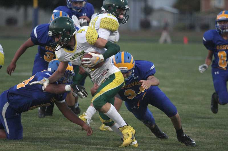 PMG PHOTO: PHIL HAWKINS - Gervais head coach Tracy Jackson lauded the teams defensive intensity, quickly swaming the Gaston ball-carriers to keep the Greyhound offense out of rhythm.